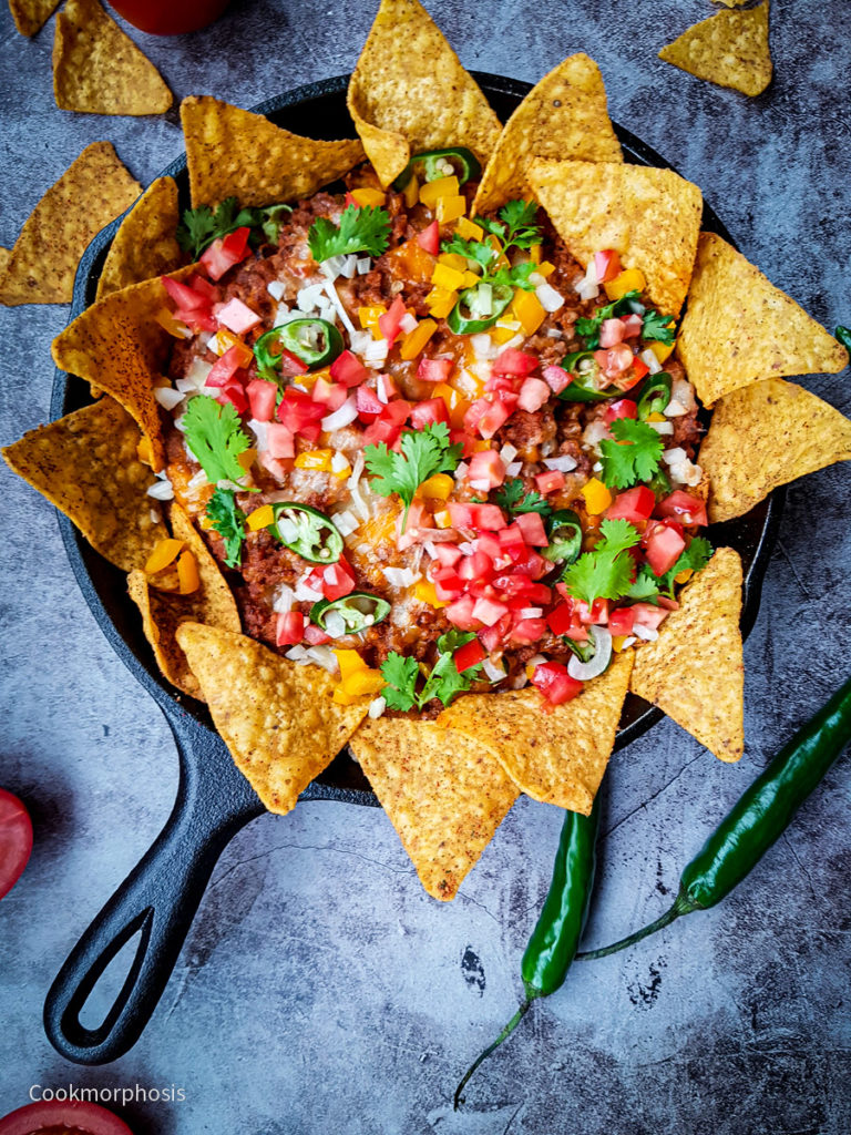 easy cheesy beef nachos served with tostitos chips, ground beef, cilantro, jalapeno, chopped tomato